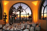 Pacific Meeting Room set for a banquet overlooking Catalina Island at sunset.